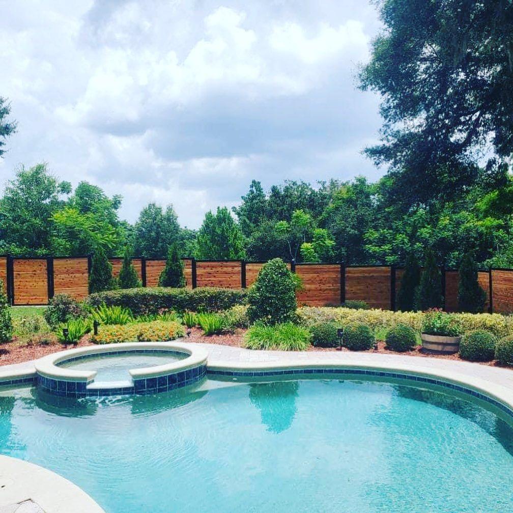 Backyard Wood and Metal Fencing with Pool